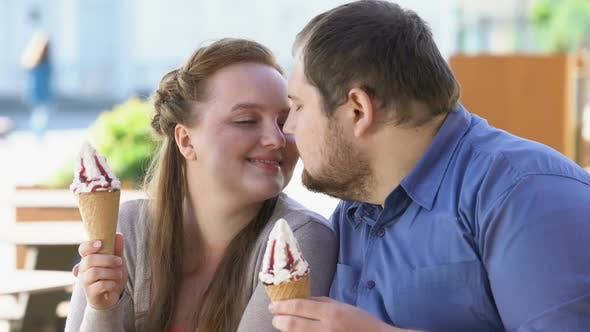 Thumbnail for Romantic Couple Nuzzling Holding Sweet Ice-Cream in Hands, Diabetes Risk