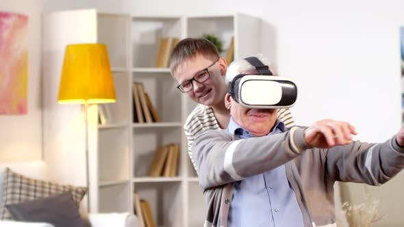 Cover Image for Joyful Granddad and Grandson Using VR Goggles