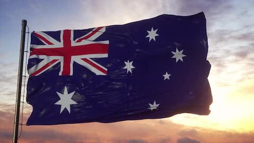 Flag of Australia Waving in the Wind Against Deep Beautiful Sky at Sunset