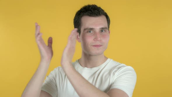 Thumbnail for Clapping Man, Applauding, Yellow Background