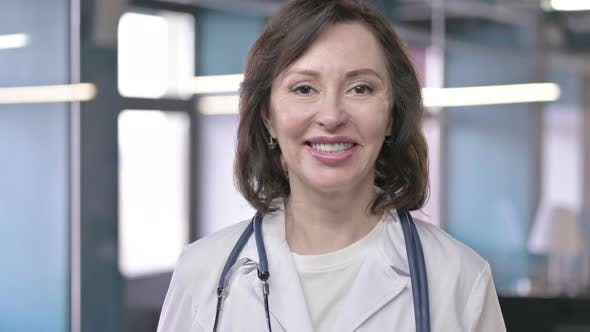 Thumbnail for Portrait of Cheerful Middle Aged Professional Doctor Looking at the Camera and Smiling