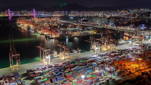 Timelapse Busan Port with Containers for Shipment at Night