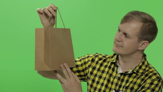 Thumbnail for Young Man on Green Screen Chroma Key Background with Shopping Bag