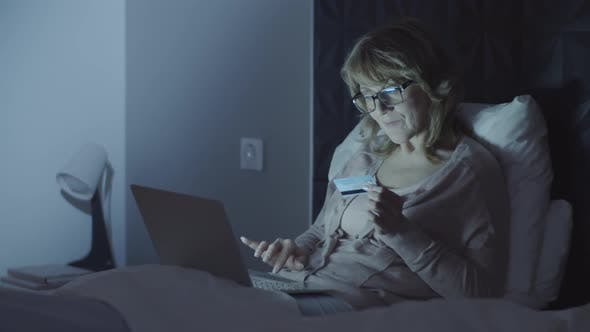 Thumbnail for Cheerful Senior Woman Doing Online Shopping at Night