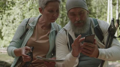 Two Aged Hikers Planning Their Route