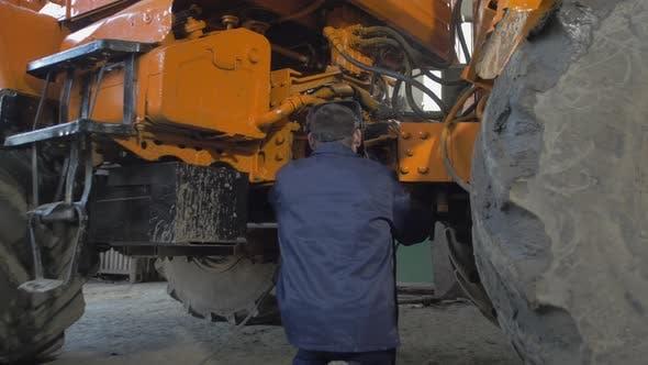 Welder repairing a vehicle