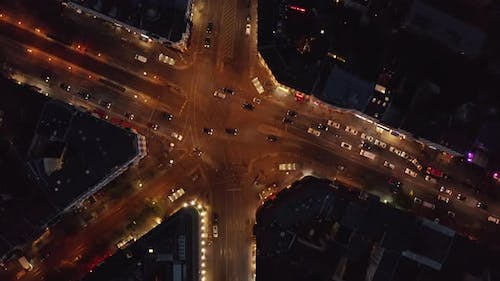 AERIAL: Birdsview of Berlin, Germany Street at Night with Traffic City Lights