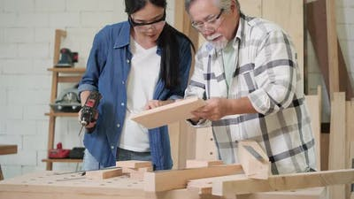 Senior man and woman working with wood