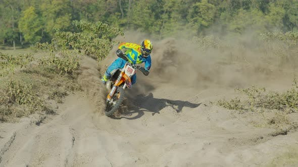 Cover Image for Rider on a motocross leaving dust behind