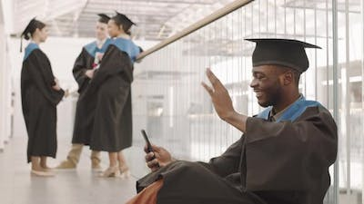 African Male Graduate Having Video Call