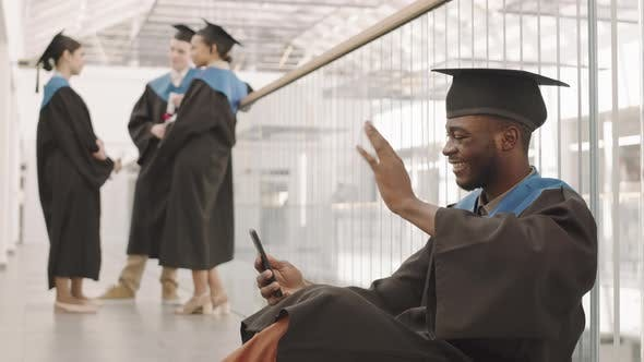 African Male Graduate Having Video Call