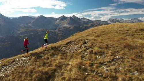Aerial View Trail Running Couple on Mountain Ridge