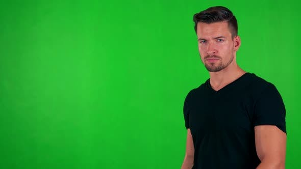 Thumbnail for Young Handsome Caucasian Man Points on Watch (Show Time) - Green Screen - Studio