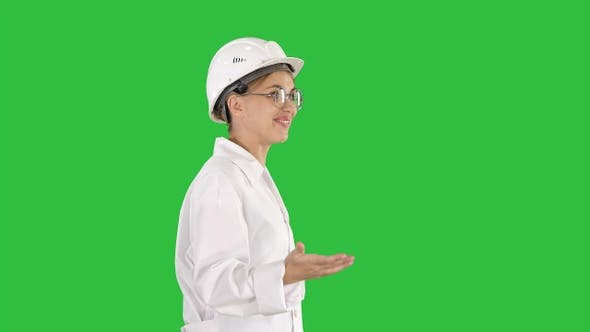 Thumbnail for Young scientist in lab coat and hardhat walking and saying