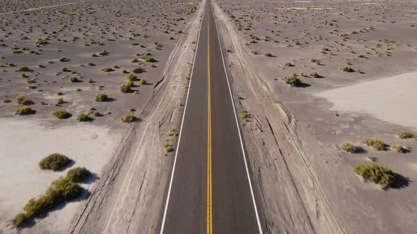 Aerial shot of a remote desert road with no cars in Nevada