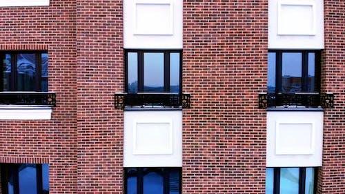 Multi-storey brick building with Windows.