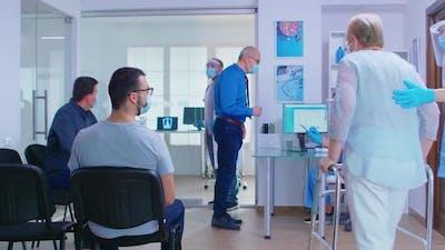 Medic Calling Patient in Consultation Room