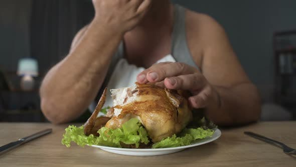 Cover Image for Bad Mannered Man Biting Greasy Fried Chicken and Licking His Fingers Addiction