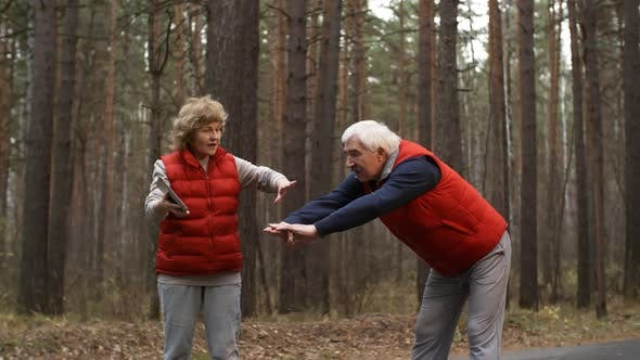 Thumbnail for Retired Athletes with Tablet in Forest