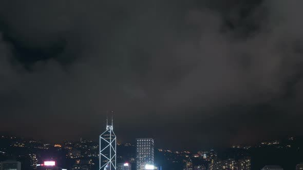 Thumbnail for Clouds Moving Over City At Night