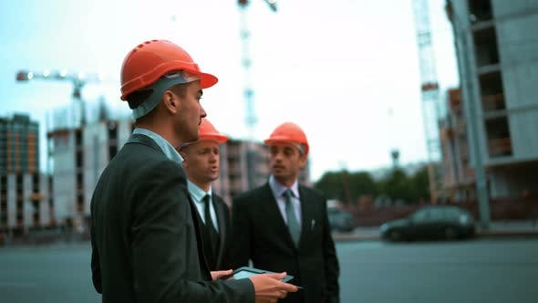 Thumbnail for Construction Worker and Businessmen Talking on Site