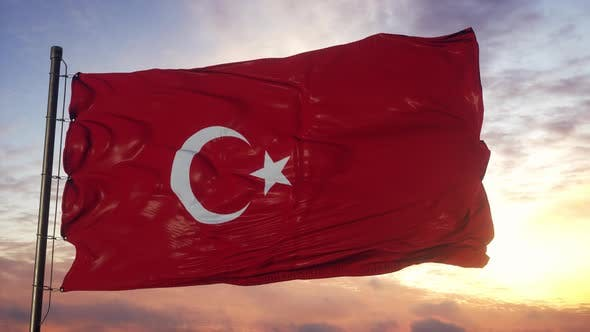 Flag of Turkey Waving in the Wind Against Deep Beautiful Sky at Sunset