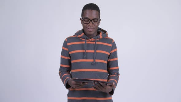 Thumbnail for Young Happy African Man Reading Book with Eyeglasses