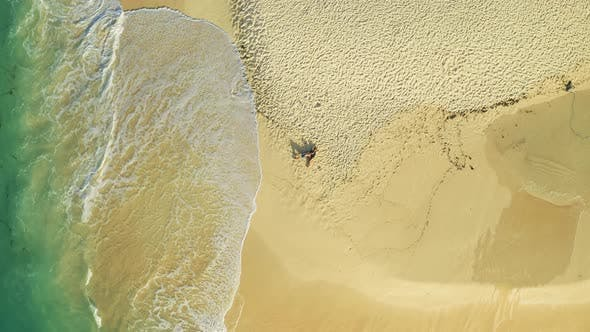 Thumbnail for Aerial Top View of Couple Lying on White Sand Beach and Azure Sea in Tropical Daku Island Beach