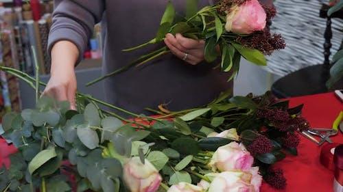 Closeup Florist Making Rose Bouquet in Workshop Flower Studio