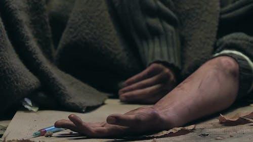 Drug Addict Having Seizure Lying on Street, Dying of Heroin Overdose, Closeup