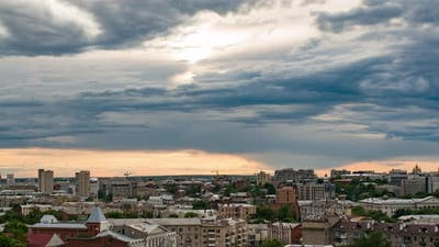 Sunset Time Lapse of the Sun Over Buildings of Kharkov City
