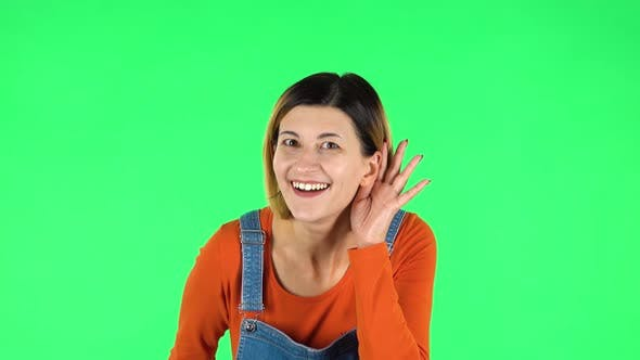 Cover Image for Woman Holding Hand Near Ear Trying To Listen To Interesting News Expressing Communication Concept