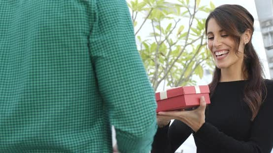 Woman receiving present from a man