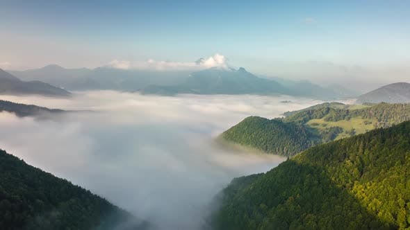 Fly above Foggy Clouds in Misty Mountains