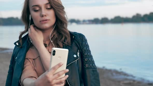 Thumbnail for Beautiful Young Woman in Headphones Looks