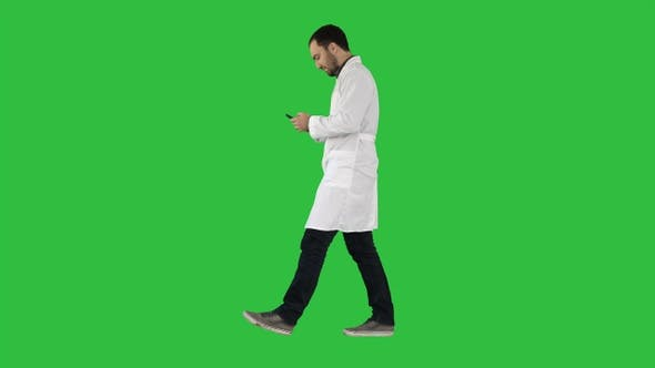 Thumbnail for Walking medical professional using smart phone and making