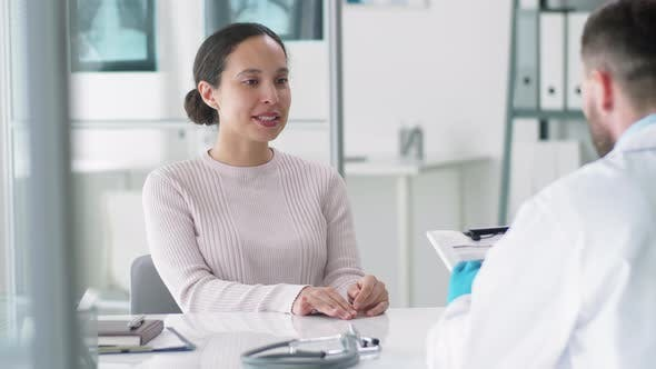 Thumbnail for Young Positive Woman Visiting Doctor in Medical Office
