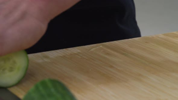 Thumbnail for Sushi chef cutting cucumber