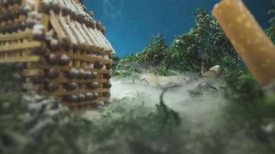 Miniature with Building of Matches Stubs and Smoke in Wood