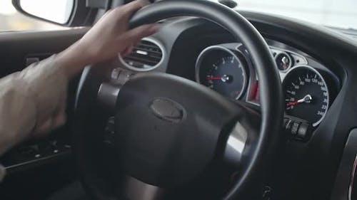 Female Hands of Steering Wheel
