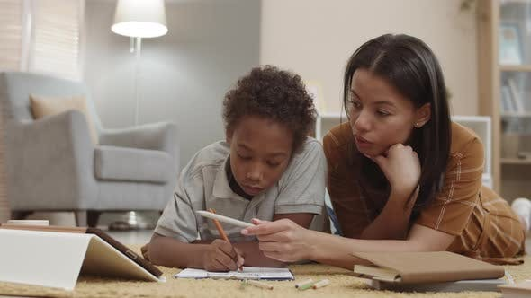 Thumbnail for Mom and Son Studying on Floor