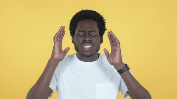 Thumbnail for African Man Gesturing Failure and Problems, Yellow Background