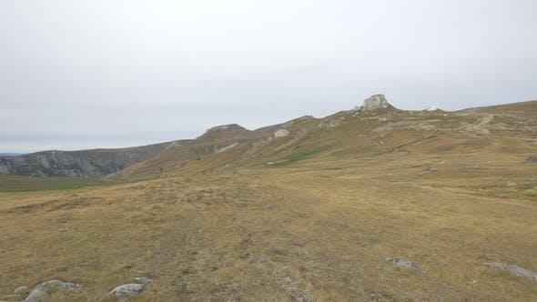 Bucegi Mountains with dried fields