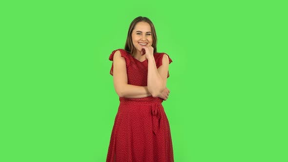 Thumbnail for Tender Girl in Red Dress Communicates with Someone in a Friendly Manner. Green Screen