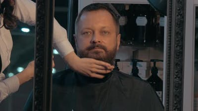Barber finishing beard trimming