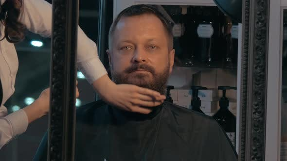 Barber finishing beard trimming