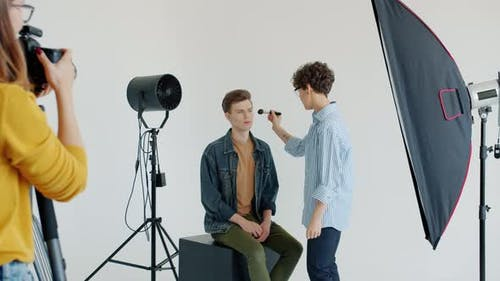 Model Working with Make-up Artist Then Posing for Camera Modelling in Studio