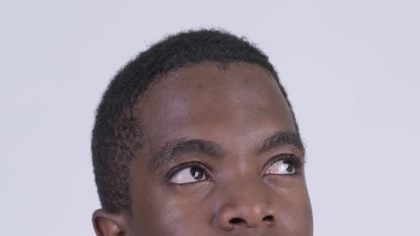 Cover Image for Eyes of Young African Man Thinking and Looking Up
