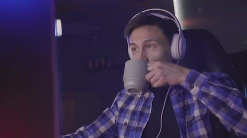 Asian Man Playing Video Games