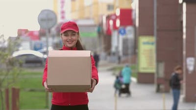Courier with box on street